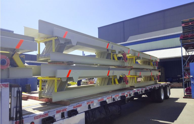 full vibrating conveyor system loaded to ship to an Optimil Machinery Inc. customer in the sawmill industry
