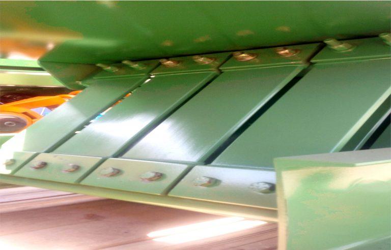 leaf spring vibrating conveyor by Optimil Machinery Inc.