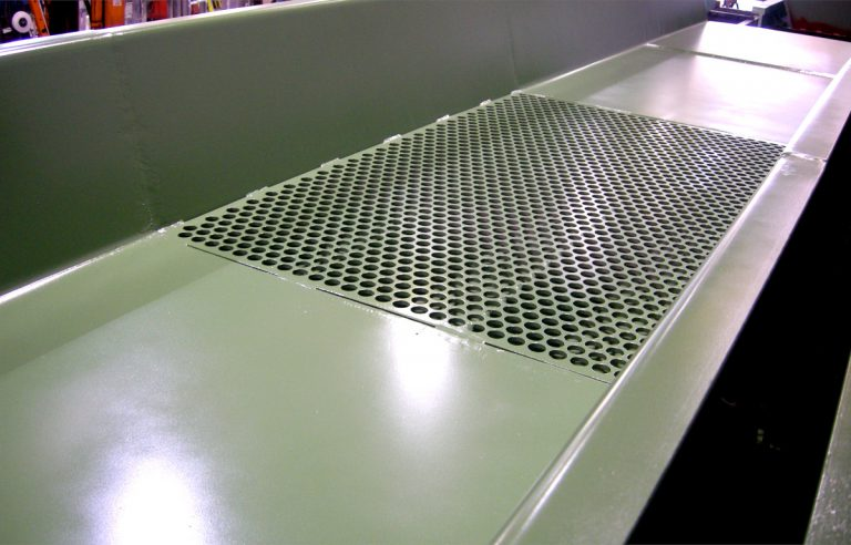 perforated plate of a vibrating conveyor made by Optimil Machinery Inc.