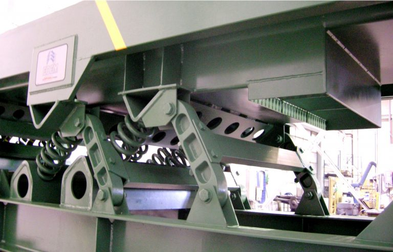 springs and underside of perforated plate of vibrating conveyor